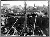 Gerechtshofbrug: bouw van de bruggehoofden 1892